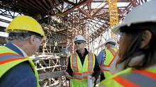 PCL project manager Jon Kindrachuck leads a tour of the Canadian Museum of Human Rights construction site in Winnipeg on Monday. (John Woods for The Globe and Mail/John Woods for The Globe and Mail)