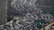 A general view of traffic during the morning rush hour in Shanghai. Several Chinese cities are trying to reduce the number of cars on their roads by offering licence plates only through auctions or lotteries. (CARLOS BARRIA/REUTERS)