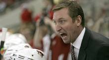 Head coach Wayne Gretzky of the Phoenix Coyotes yells at a referee against the Carolina Hurricanes during their game at the RBC Center on November 21, 2008 in Raleigh, North Carolina. (Photo by Streeter Lecka/Getty Images)