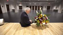 Leo Plue Executive Director of the Abilities Centre for the disabled in Whitby places what will be the first of many flowers in the room where late Jim Flaherty will lie for visitation tomorrow. Plue is also Flaherty's brother-in-law, April 14, 2014. (FRED THORNHILL For The Globe and Mail)
