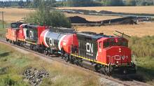 Two locomotives paired with a tank car fuel tender. (CN)
