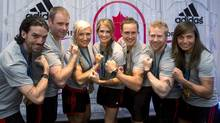 Canadian winter Olympians (left to right) Charles Hamelin, Chris Del Bosco, Kaillie Humphries, Meaghan Mikkelson, Erik Guay, Jon Montgomery and Maelle Ricker pose for a photo at an event announcing the sponsorship of the team by Adidas in Toronto on Tuesday June 25, 2013. (Frank Gunn/THE CANADIAN PRESS)