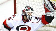 The Carolina Hurricanes will rely heavily on goalie Cam Ward as the NHL playoff race heats up. REUTERS/Shaun Best (SHAUN BEST)