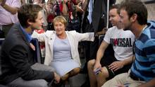 PQ leader Pauline Marois and candidate and former student leader Leo Bureau-Blouin chat with commuter as they ride a subway Thursday, August 2, 2012 in Montreal. Quebecers will go to the polls for a provincial election Tuesday, Sept. 4. (Paul Chiasson/THE CANADIAN PRESS)