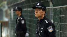 As a diplomatic feud brews, Chinese police stand guard outside the Japanese embassy in Beijing on Sept. 19. (Peter Parks/AFP/Getty Images)