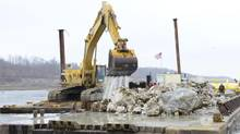 A backhoe removes chunks of limestone from the navigation channel on the Mississippi River near Thebes, Ill., Dec. 17, 2012. Some shippers of grain, coal and steel have worried parts of the river will close to navigation due to low water. (HANDOUT/REUTERS)