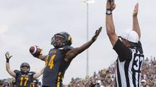 Hamilton Tiger-Cats receiver Bakari Grant celebrates his touchdown against the Toronto Argonauts (Aaron Lynett/THE CANADIAN PRESS)
