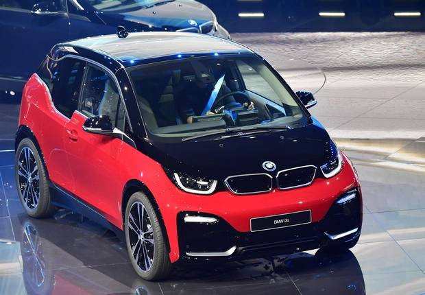 A BMW i3s car is displayed during a show at the stand of German carmaker BMW at the Frankfurt Motor Show IAA in Frankfurt am Main, western Germany, on September 12, 2017. According to organisers, around 1,000 exhibitors from 39 countries will showcase their products and services. This year's fair running from September 14 to 24, 2017 will focus on digitization, urban mobility and electric mobility.