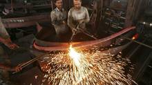 Labourers work inside an iron factory on the outskirts of Jammu November 12, 2012. Canadian businesses could do more to take advantage of India's great growth prospects. (MUKESH GUPTA/REUTERS)