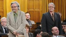 NDP MPs John Rafferty and Bruce Hyer vote in favour of Bill C-19, a bill to scrap the long-gun registry, on Feb. 15, 2012. Both men lost their positions as NDP critics and were barred from making members' statements in the House. (Sean Kilpatrick/THE CANADIAN PRESS)