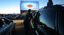 A drive-in theatre moment at The 5 Drive In in Oakville, Ont. (GLENN LOWSON FOR THE GLOBE AND MAIL)