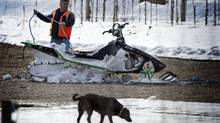 A damaged snowmobile retrieved from the scene of the avalanche by helicopter on Sunday. (JOHN LEHMANN/John Lehmann/The Globe and Mail)