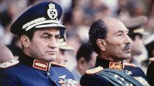 Hosni Mubarak, left, with Anwar Sadat (AP)