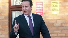 Britain's Prime Minister David Cameron visits the Windmill Community Centre in Smethwick, Birmingham, on Dec. 15, 2011. (Reuters)