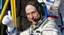 International Space Station (ISS) crew member, U.S. astronaut Donald Pettit, gives the thumbs up as he boards the Soyuz TMA-03M spacecraft at Baikonur cosmodrome, December 21, 2011. (SHAMIL ZHUMATOV/REUTERS/SHAMIL ZHUMATOV/REUTERS)