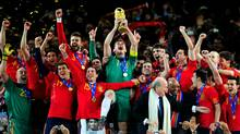 Iker Casillas of Spain celebrates lifting the World Cup with teammates. (Jamie McDonald/2010 Getty Images)