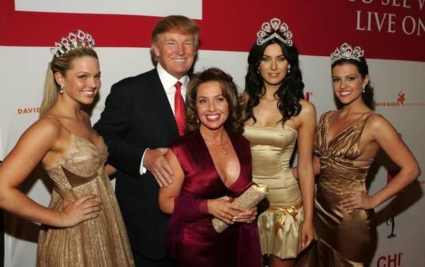 Donald Trump, as president the Miss Universe pageant, shares the spotlight with its 2005 winners.