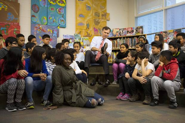 Federal Finance Minister Bill Morneau is joined by students from Toronto's Rose Avenue Junior Public School during a pre-budget photo opportunity on Feb. 23, 2018.