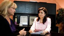 Tina Tehranchian, (R) Financial Planner meets with her client , Anna Zsolnay (L). (Sami Siva)