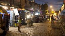 In a photo taken May 25, 2011, a sex worker waits for customers at the Vila Mimosa prostitution zone in Rio de Janeiro. (FELIPE DANA/ASSOCIATED PRESS)