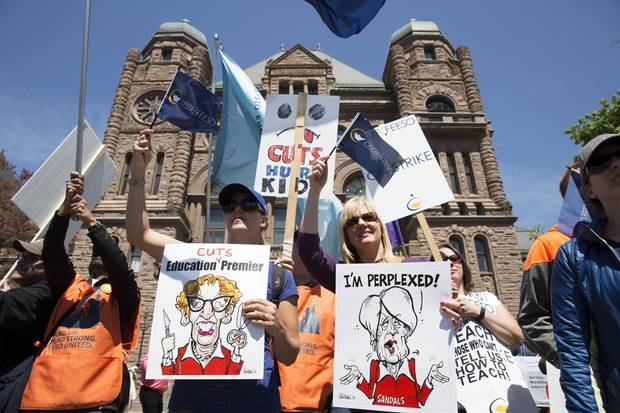 Teachers on strike rally outside of Queen's Park in Toronto on May 14, 2015.