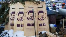 Protests are legal again in Kiev after one wealthy oligarch persuaded President Viktor Yanukovych to repeal some draconian laws. (THOMAS PETER/Reuters)