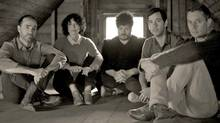 The Shins sitting in an attic.