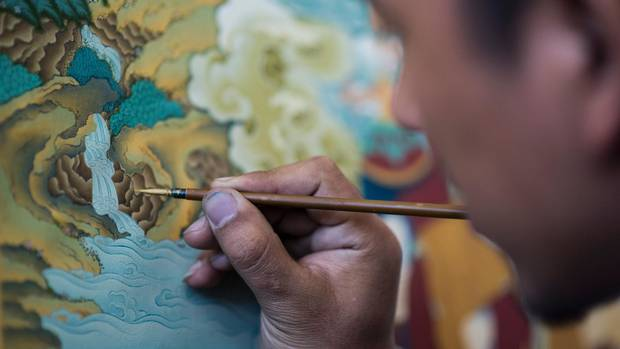 A student paints an example of the medieval Tibetan art of thangka on Sept. 10 at the Danba Raodan art school in Lhasa.