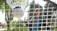 Allison Wong plays badminton at her home in Vancouver. (JOHN LEHMANN/The Globe and Mail)