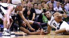 San Antonio Spurs forward Boris Diaw (33) and San Antonio Spurs forward Kawhi Leonard (2) fight for a loose ball with Miami Heat guard Dwyane Wade (3) in game two of the 2014 NBA Finals at AT&T Center on June 8, 2014. (Bob Donnan/USA Today Sports)
