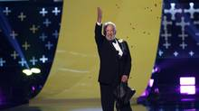 """Actor Donald Sutherland accepts the choice movie villain award for """"The Hunger Games: Catching Fire"""" onstage during the Teen Choice Awards 2014 in Los Angeles, California August 10, 2014. (MARIO ANZUONI/REUTERS)"""