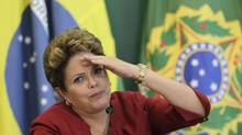 Brazil's President Dilma Rousseff speaks during breakfast with reporters at the Planalto Palace in Brasilia Dec. 27, 2012. (UESLEI MARCELINO/REUTERS)