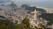 The statue of Christ the Redeemer towers over Rio de Janeiro (Felipe Dana)