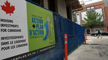 A government Economic Action Plan sign adorns a social housing project under construction in Vancouver on May 24, 2010. (DARRYL DYCK/Darryl Dyck for The Globe and Mail)