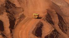 A tipper truck climbs out of an iron ore mine. (TIM WIMBORNE/REUTERS)