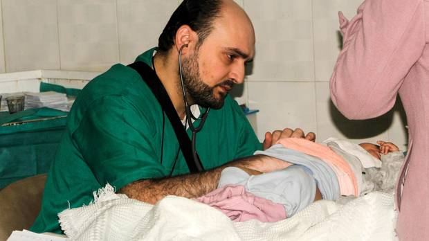 A picture taken on February 20, 2016 and released on April 29, 2016 by the Independant Doctors Association (IDA), a Syrian humanitarian NGO, shows Syrian doctor Muhammad Waseem Maaz working at Aleppo's pediatric hospital. Muhammad Waseem Maaz was killed on April 27, 2016 along with four colleagues and 22 civilians when air strikes hit al-Quds hospital.