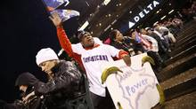 Dominican Republic fans cheer with a sign bearing plantains during the World Baseball Classic final against Puerto Rico in San Francisco, March 19, 2013. (STEPHEN LAM/REUTERS)