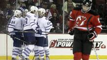 New Jersey Devils' Adam Larsson, right, of Sweden, reacts as members of the Toronto Maple Leafs celebrate a goal by Joffrey Lupul during the second period of an NHL hockey game on Wednesday, Nov. 2, 2011, in Newark, N.J. (Julio Cortez/AP)