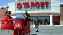 Shoppers come out from the Target store in Boston in this file photo. (CHITOSE SUZUKI/CHITOSE SUZUKI/AP)