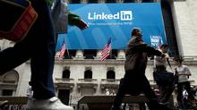 A LinkedIn Corp. banner hangs on the front of the New York Stock Exchange in New York, U.S., on Thursday, May 19, 2011. LinkedIn Corp., the largest professional-networking website, more than doubled in the first day of trading after its initial public offering. (Michael Nagle/Michael Nagle/Bloomberg)