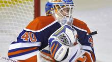 Edmonton Oilers goalie Devan Dubnyk makes a save against the Colorado Avalanche during the second period of their NHL game in Edmonton January 28, 2013. (DAN RIEDLHUBER/REUTERS)