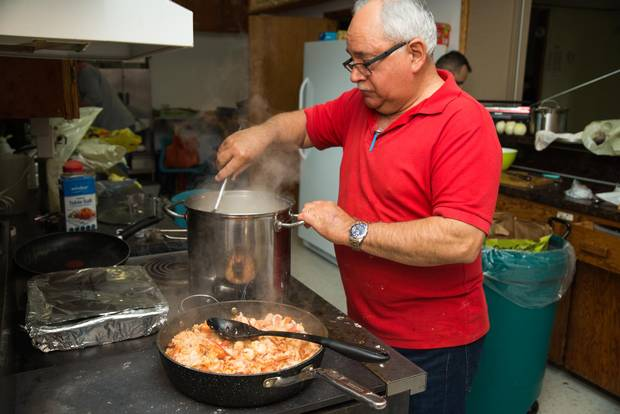 Volunteer George Doucette stirs the chowder.