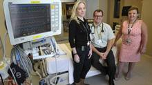 William Osler Health System doctors Alex Mcmillan, Andrew Healey and Susan Lavery pose in the ICU in Brampton on June 26, 2014. (J.P. MOCZULSKI FOR THE GLOBE AND MAIL)