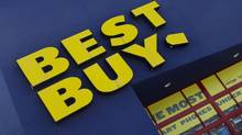 The Best Buy logo is displayed on a store in Miami, Fla. (J Pat Carter/AP)