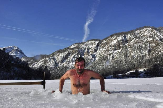 Wim Hof of the Netherlands, known as the Iceman, prepares for a performance in a tank of ice for German Television, in Inzell, Germany.
