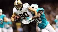 New Orleans Saints tight end Jimmy Graham (80) fights off Miami Dolphins strong safety Chris Clemons (30) on his way to scoring a touchdown in the third quarter at Mercedes-Benz Superdome. (Crystal LoGiudice/USA TODAY Spor)