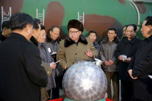 North Korean leader Kim Jong-un meets scientists and technicians in the field of nuclear-weapons research in this undated photo released by North Korea's official news agency on March 9, 2016.