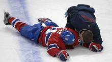 Montreal Canadiens' Lars Eller lies injured on the ice following a hit by Ottawa Senators' Eric Gryba (not shown) during second period of game one first round NHL Stanley Cup playoff hockey action in Montreal, Thursday, May 2, 2013. (Graham Hughes/THE CANADIAN PRESS)