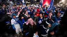 Laura-lee Jack celebrates with a crowds of fans as the Toronto Maple Leafs take a 2-1 win over the Boston Bruins during Game 6 of the Eastern Conference quarter-final at Toronto's Maple Leaf Square on Sunday, May 12, 2013. (Michelle Siu/The Globe and Mail)