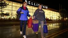 Becky Hind and her sister Sherie Cobb leave Bellis Fair Mall after a Black Friday shopping spree in Bellingham, Wash. on Nov. 23, 2012. (Jeff Vinnick for The Globe and Mail)